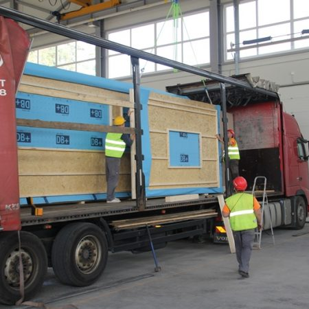 wood panel house delivery truck loading